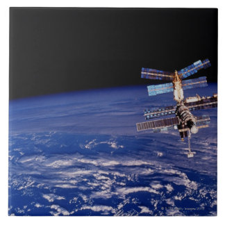 Mir Space Station floating above the Earth Tile