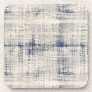 Mirada azul descolorada del dril de algodón posavaso