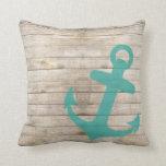 Mirada azul náutica femenina del ancla y de madera almohada