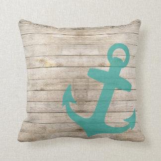 Mirada azul náutica femenina del ancla y de madera cojín