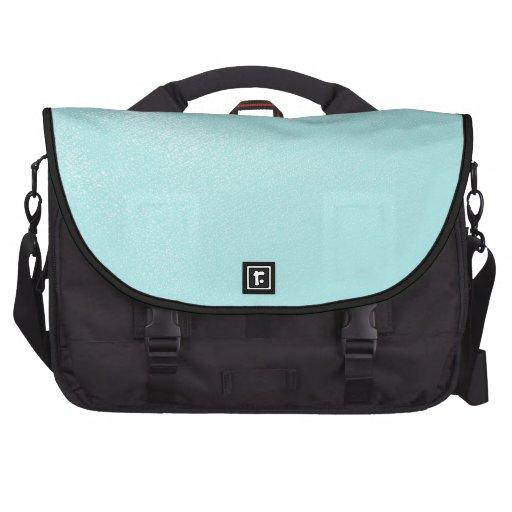 Mirada de cuero azul en colores pastel bolsas de portatil
