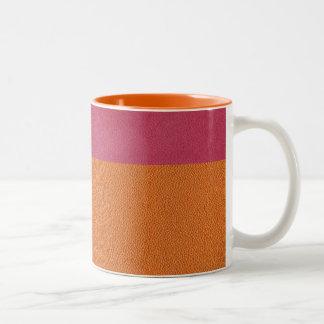 Mirada de cuero rosada y anaranjada tazas