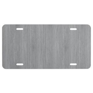 Mirada de madera de bambú del grano del gris de placa de matrícula
