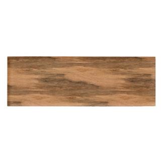 Mirada de madera del grano del eucalipto natural etiqueta con nombre