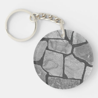 Mirada de pavimentación de piedra gris decorativa llavero