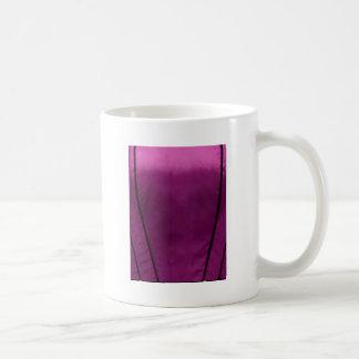Mirada elegante de la tela de seda del satén - aña taza de café
