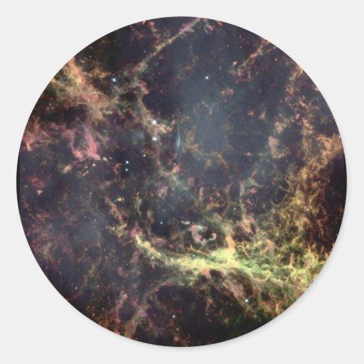 Mirada en el corazón de la nebulosa de cangrejo etiquetas redondas