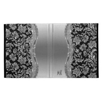 Mirada-Monograma del acero inoxidable de la plata