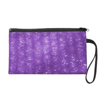 Mirada púrpura del plástico de burbujas de la