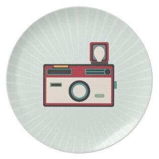 Mirada retra de la cámara del vintage plato de cena