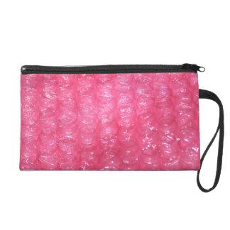 Mirada rosada del plástico de burbujas de la noved