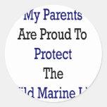 Mis padres son orgullosos proteger al Li marino Pegatinas Redondas