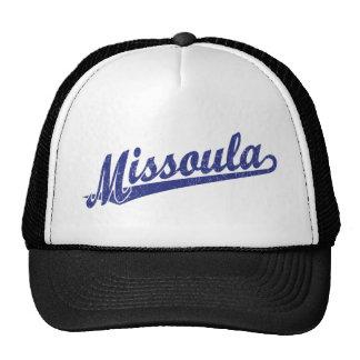 Missoula script logo in blue distressed trucker hat