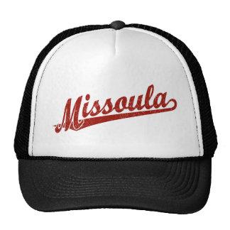 Missoula script logo in red distressed trucker hat