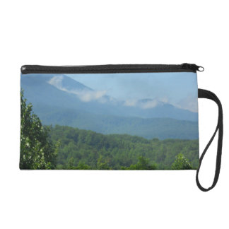 Mist on the mountain top wristlet clutches