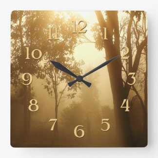 Misty Forest Beautiful Sunlight Trees Gold Sepia Square Wall Clocks