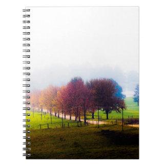 Misty meadow in autumn spiral notebook