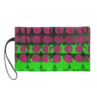 Mitón verde y negro con los círculos rosados