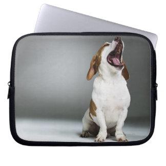Mixed breed dog yawning laptop sleeves