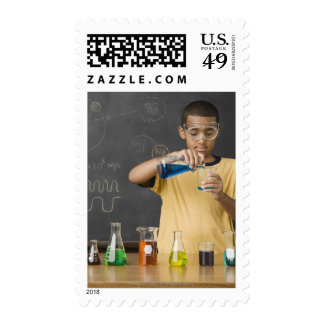 Mixed Race boy in science class Postage Stamp