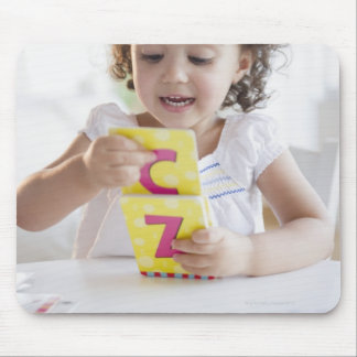 Mixed race girl playing with alphabet cards mouse pad