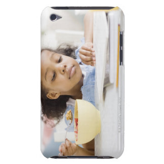 Mixed race girl reading and eating breakfast iPod touch case