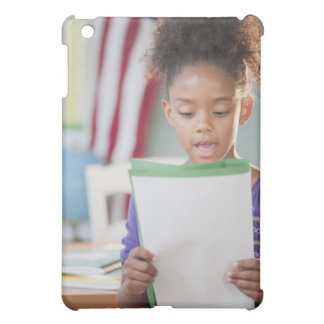 Mixed race girl reading report at school case for the iPad mini