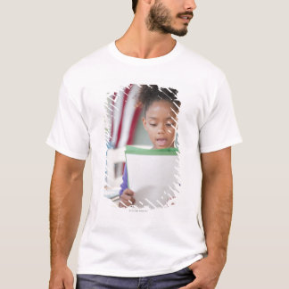 Mixed race girl reading report at school T-Shirt