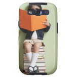 Mixed race girl sitting on stack of books samsung galaxy s3 cases