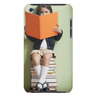 Mixed race girl sitting on stack of books iPod touch case