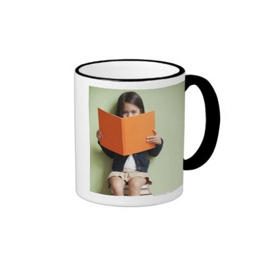 Mixed race girl sitting on stack of books ringer coffee mug