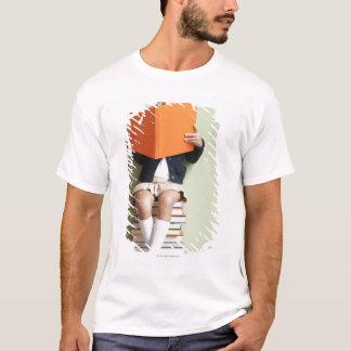 Mixed race girl sitting on stack of books T-Shirt