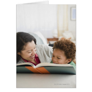 Mixed race mother reading book to son cards