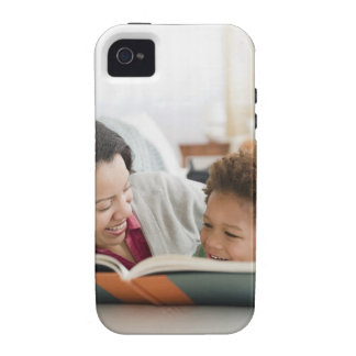 Mixed race mother reading book to son iPhone 4/4S cover