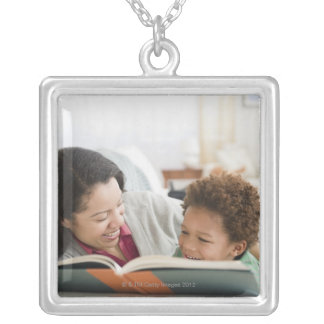 Mixed race mother reading book to son silver plated necklace