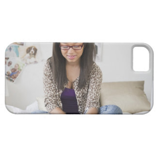 Mixed race teenage girl doing homework on bed iPhone SE/5/5s case