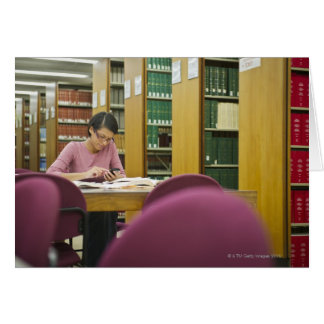 Mixed race woman doing research in library 2 greeting cards