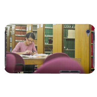 Mixed race woman doing research in library 2 iPod touch covers
