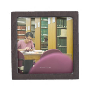 Mixed race woman doing research in library 2 keepsake box