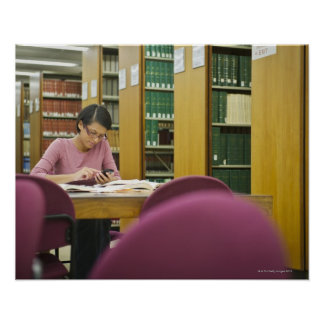 Mixed race woman doing research in library 2 poster