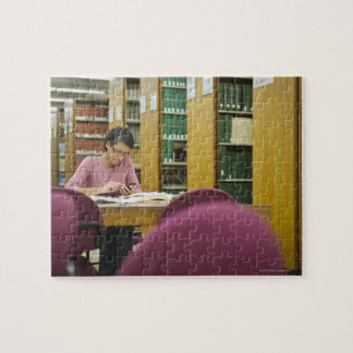 Mixed race woman doing research in library 2 jigsaw puzzle