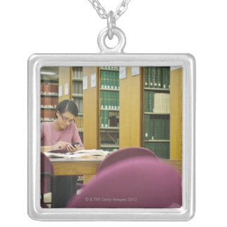 Mixed race woman doing research in library 2 square pendant necklace