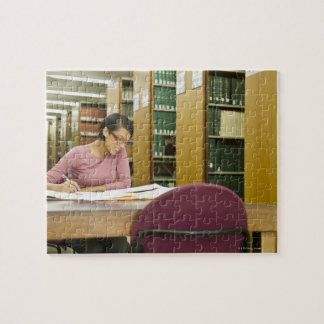 Mixed race woman doing research in library puzzle
