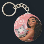 "Moana | Pacific Island Girl Keychain<br><div class=""desc"">Let us introduce Moana and her adorable best friend,  Pua from Disney&#39;s awesome animated adventure. Here we see the Polynesian princess holding her precious pot-bellied pig against a tropical background. Kids will love this fun and colorful design of the island goddess and her cute little pet!</div>"