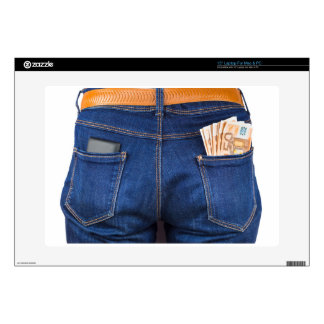Mobile phone and euro money in blue jeans laptop skins