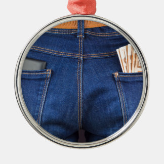 Mobile phone and euro money in blue jeans metal ornament
