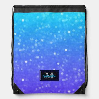 Mochila azul y púrpura del monograma de la luz