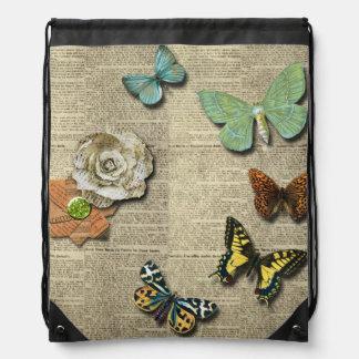 Mochila floral del lazo del periódico de la maripo