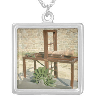 Model of a hydraulic saw silver plated necklace