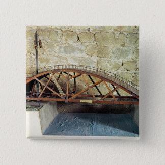 Model of a swing bridge button